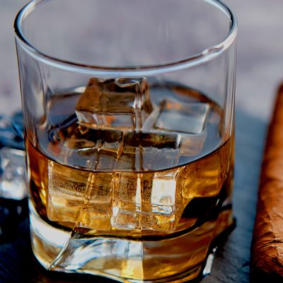 cognac glass and cuban cigar
