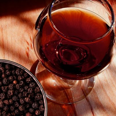 glass of port wine and bowl of pepper